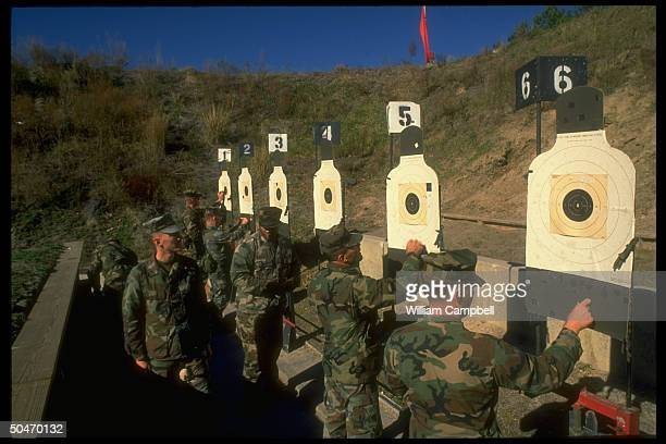 US Marines on pistol range at Cherry Point practicing their aim as 2nd Expeditionary Force comrades leave for gulf crisis duty in Saudi Arabia