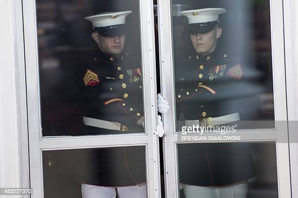 US Marines open the door to the White House to greet guests for a group dinner during the US Africa Leaders Summit August 5 2014 in Washington DC AFP...