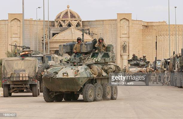 Marines operate light armored vehicles in front of Saddam Hussein Palace April 14 2003 in Tikrit which is located approximately 175 km north of...