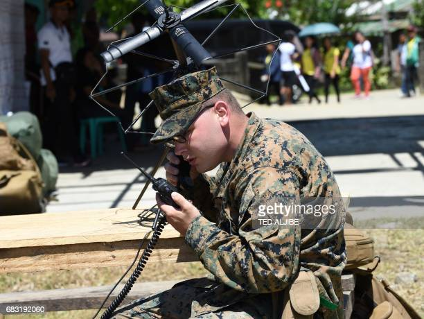 A US marines operates communication equipment during a simulation of a disaster drill as part of the annual joint PhilippinesUS military exercise in...