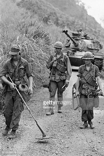 U S Marines part of a force advancing up South Vietnam's Highway 9 during the conduct of Operation Pegasus probe for mines in the path of a tank By...