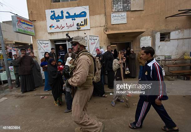 Marines patrol February 17, 2007 in the Husayba, Iraq downtown market area. Husayba, a strategic border crossing with Syria along the Euphrates...
