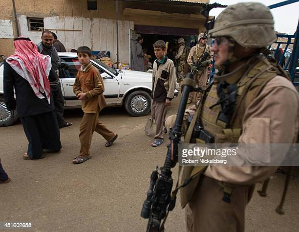 S Marines patrol February 17 2007 in the Husayba Iraq downtown market area Husayba a strategic border crossing with Syria along the Euphrates River...