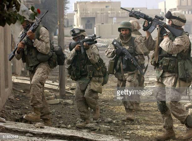 US marines patrol the restive city of Fallujah 50 kms west of Baghdad 12 December 2004 Marines were continuing their hunt for rebels in Fallujah...