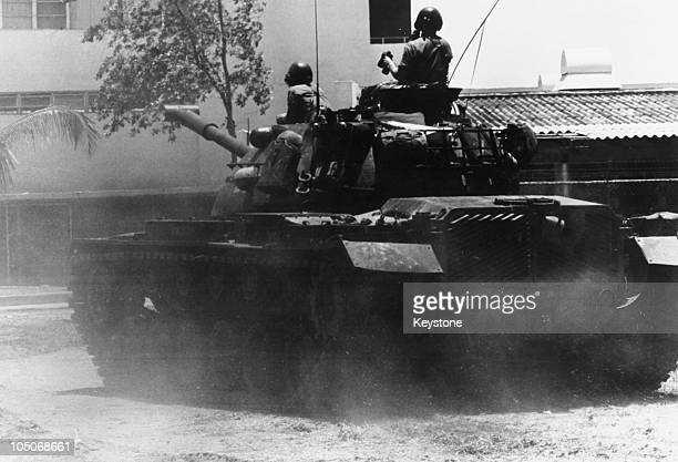 US Marines patrol the streets of Santo Domingo in a tank during the US occupation of the Dominican Republic 10th May 1965