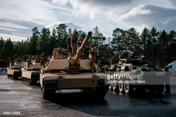 US Marines prepare the M1 Abrams tanks and the LAV25 an eightwheeled amphibious armored reconnaissance vehicle to take part in an exercise to capture...