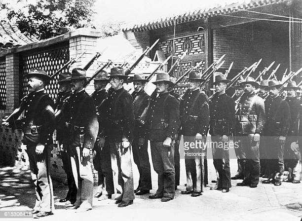 Marines prepare to relieve troops involved in the Boxer Rebellion Peiping China 1900