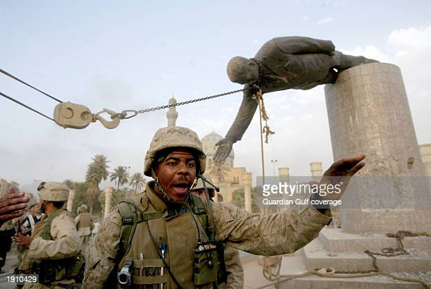 US Marines pull down a statue of Saddam Hussein in the centre of Baghdad