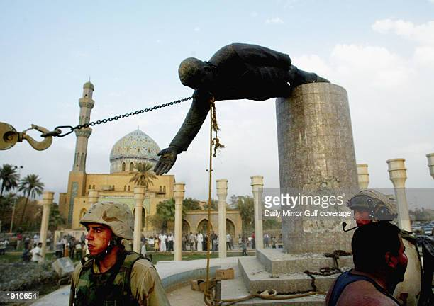 US Marines pull down the statue of Saddam Hussein in the centre of Baghdad April 9 2003