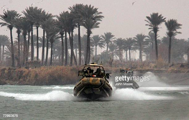 S Marines race along the Euphrates River east of Ramadi January 13 2007 in Iraq's Anbar province The Marines were searching for crossing points on...