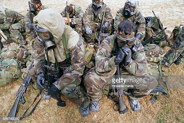 US Marines rest in their gas masks after a biologicalweapons training exercise in Camp Lejeune | Location MCB Camp Lejeune North Carolina USA