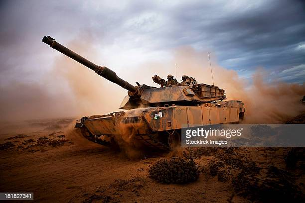 marines roll down a dirt road on their m1a1 abrams main battle tank during a day of training at exercise africa lion 2012. - armored tank stock photos and pictures