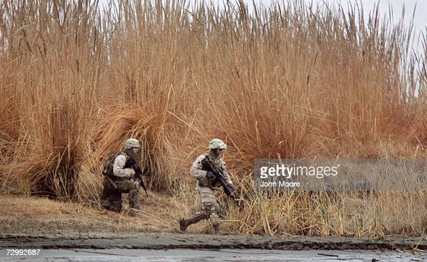 S Marines run along the Euphrates River after being fired on by insurgents east of Ramadi January 13 2007 in Iraq's Anbar province The Marines were...