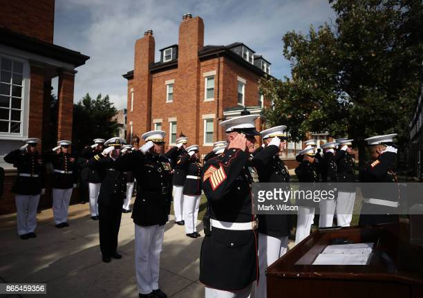 Marines salute during a ceremony to commemorate the anniversary of the 1983 bombing of the Marine barracks in Beirut Lebanon at the Marine barracks...