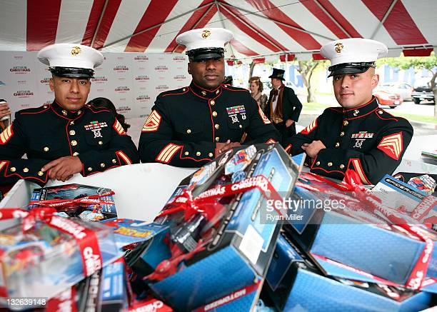 US Marines Sargent Carlos Rodriguez Gunnery Sargent Marquis Young and Sargent Gabriel Hernandez keep watch over the Toys for Tots presents as the 12...