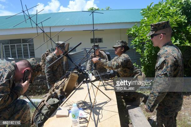 US marines set up their communication equipment during a simulation of a disaster drill as part of the annual joint PhilippinesUS military exercise...