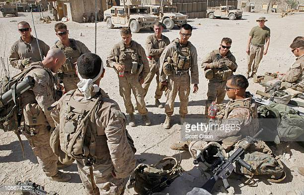 S Marines Sgt Aaron Segovia of Houston Texas with India Battery 3rd Battalion 12th Marine Regiment informs his squad of the death of one of their...
