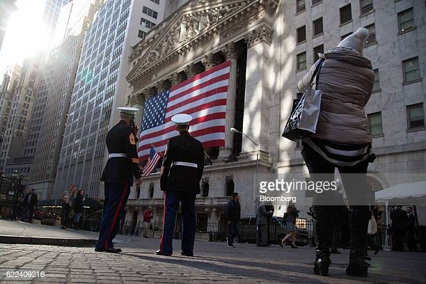 Marines stand as an American flag is displayed at the New York Stock Exchange in New York US on Friday Nov 11 2016 US stocks fluctuated in whipsaw...
