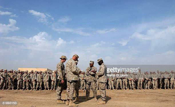 Marines stand in formation to attend the speech of the Commanding General of the US Marines 1st Expeditionary Force Lt Gen John F Sattler...