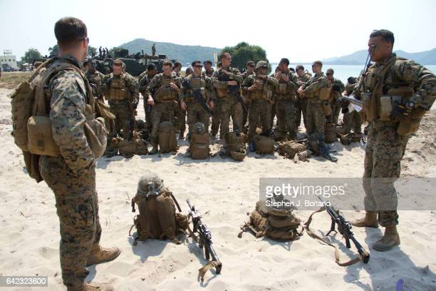 Marines stand on the beach head during the USThai joint military exercise titled 'Cobra Gold' on Hat Yao beach in Chonburi province eastern Thailand...