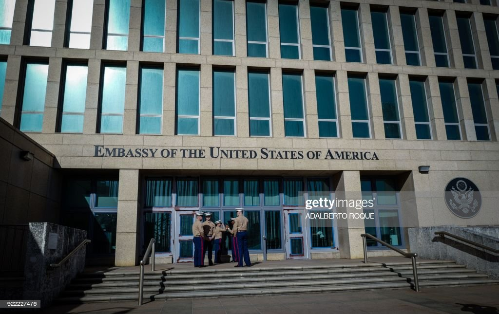 US Marines stand outside the Embassy of the United State of America in Havana, on February 21, 2018. /