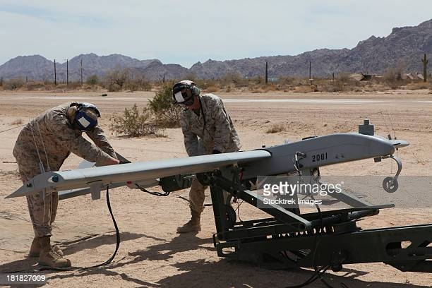 u.s. marines start the engine of an rq-7 shadow. - military drones stock photos and pictures