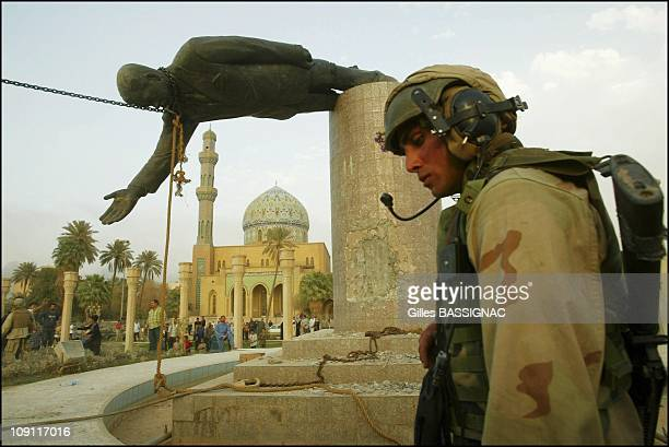 S Marines' Stories In Iraq In April 2004 In Iraq A Us Marine Stands Near The Statue Of Saddam Hussein As It Is Being Felled On Al Ferdaus Square In...