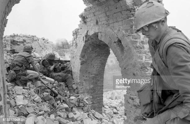 US Marines take position atop a battered wall on the periphery of the ancient imperial city It was reported that the allied advance had stalled short...
