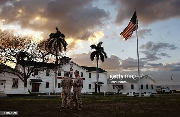 US Marines talk in front of the Marine headquarters known as the 'white house' at the US Naval Base on October 29 2009 at Guantanamo Bay Cuba The...