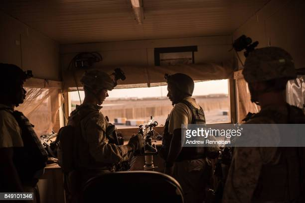 S marines talk to Ugandan contractors at a guard station at Camp Shorab on September 11 2017 in Helmand Province Afghanistan About 300 marines are...
