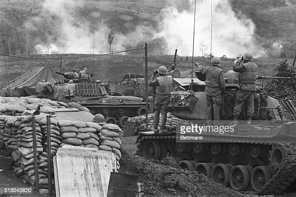 US Marines tank crews watch results of American air support from inside the allied base on March 1st just below the DMZ US Leathernecks later laid...