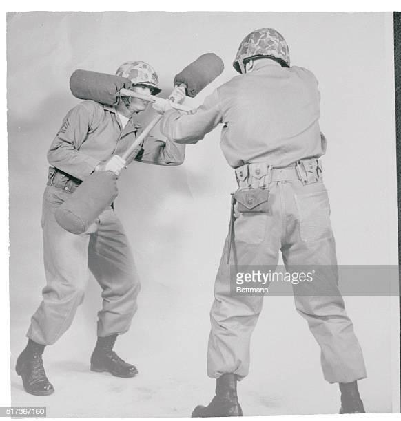 Marines Test New System of Bayonet Fighting Washington US Marine trainees practice handtohand combat using protective equipment and pugil sticks...
