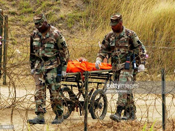 S Marines transport a detainee on a guerney in Camp XRay February 6 2002 in Guantanamo Bay Cuba Many of the 156 Al Qaeda or Taliban detainees are...