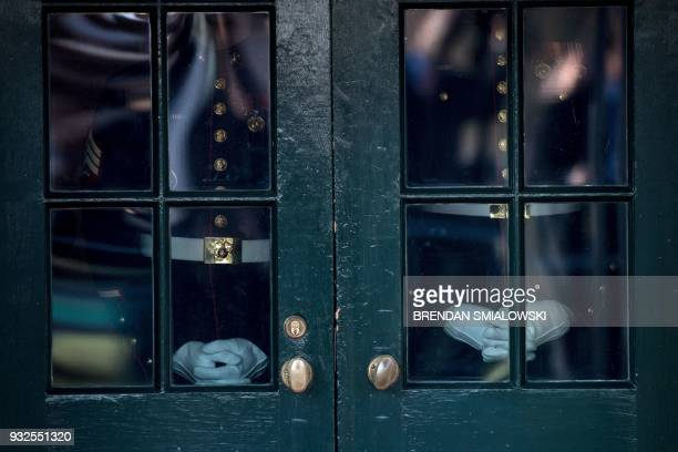 US Marines wait to open a door for US President Donald Trump and US first lady Melania Trump to greet Ireland's Prime Minister Leo Varadkar outside...