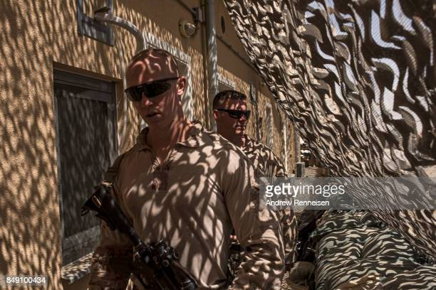 S marines walk down a hallway at Camp Bost on September 11 2017 in Helmand Province Afghanistan About 300 marines are currently deployed in Helmand...
