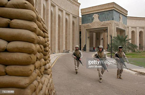 Marines walk past the front of the American Embassy February 6, 2007 in Baghdad, Iraq . The platoon of Marines from the Anti-Terrorism Battalion is...