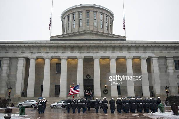 Marines walk the casket of John Glenn down the stairs of the Ohio Statehouse during his memorial procession in Columbus, Ohio on December 17, 2016. A...