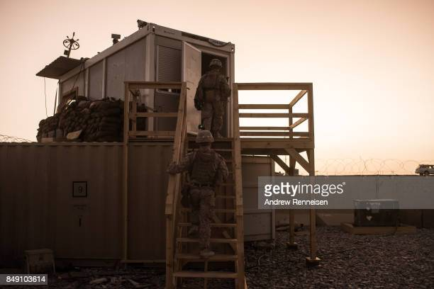 S marines walk to a guard station at Camp Shorab on September 11 2017 in Helmand Province Afghanistan About 300 marines are currently deployed in...