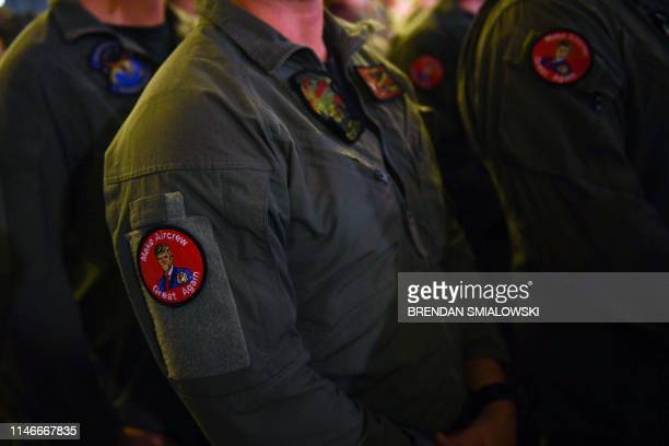 US Marines wearing badges listen to US President Donald Trump during a Memorial Day event aboard the amphibious assault ship USS Wasp in Yokosuka on...
