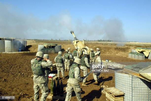 Marines with 4/14 marines Mike Battery fire at insurgents in Fallujah with a 155mm Howitzer canon 09 November 2004 50 kms west of Baghdad US troops...