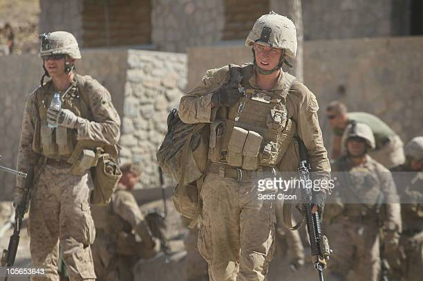 S Marines with India Battery 3rd Battalion 12th Marine Regiment return from a patrol near Forward Operating Base Zeebrugge on October 17 2010 in...