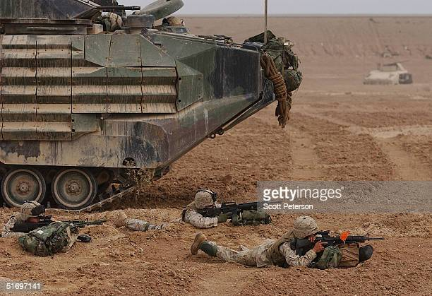 S Marines with the 1st Battalion 3rd Marines take up battle positions to assault Fallujah on the northern lip of the city November 8 2004 in Fallujah...