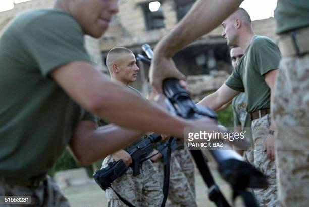 US marines with the 1st Marine Brigade practice closecombat techniques at their main base in Ramadi 23 October 2004 located in a partially destroyed...