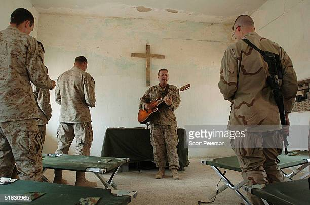US Marines with the 1st Marine Expeditionary Force attend a Sunday church service in a makeshift chapel as they prepare for an expected allout...