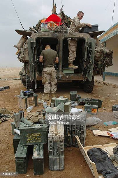 US Marines with the 1st Marine Expeditionary Force clean out an armored vehicle as they prepare for an expected allout military offensive against...