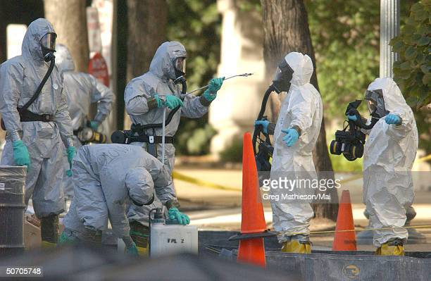 Marines with the Chemical Biological Incident Responce Force working in hazmat gear as they decontaminate the Longworth House Office building of...