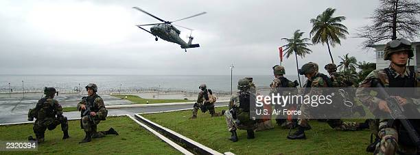 S Marines with the Fleet Antiterrorism Security Team based out of US Naval Air Station Rota Spain provide security for a HH60G Pavehawk helicopter...