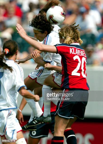 Marinette Pichon of France goes up for a ball against Lise Klaveness of Norway in the FIFA Women's World Cup USA 2003 at Lincoln Financial Field in...