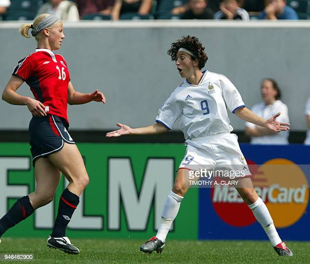Marinette Pichon of France questions a call as Gunhild Folstad of Norway looks on in the FIFA Women's World Cup USA 2003 at Lincoln Financial Field...