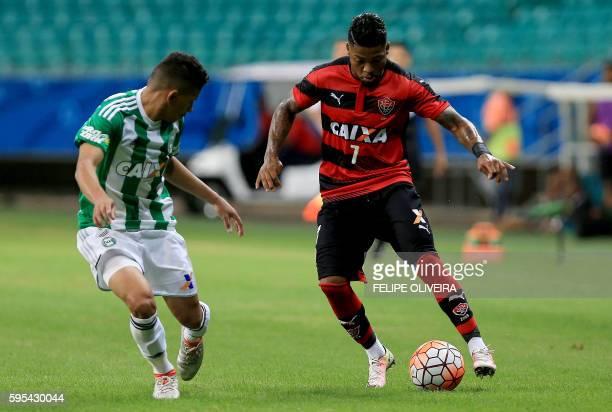 Marinho of Brazilian Vitoria vies for the ball with Dodo of Brazilian Coritiba during their 2016 Copa Sudamericana football match at the Arena Fonte...